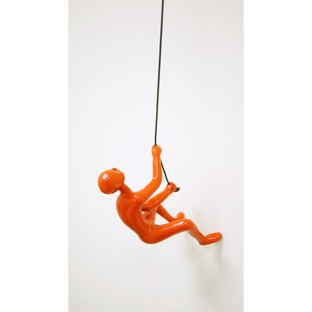 Orange Climbing Man Wall Art Sculpture - Image 2 of 5