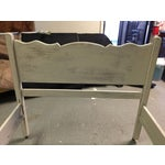 Image of Vintage painted bed in a shabby chic style