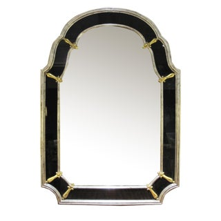 A glamorous American Hollywood regency 1960's silver gilt wood mirror with black glass border