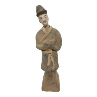 Ancient Chinese Figure Holding a Rabbit