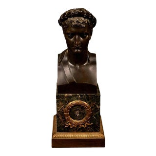 Patinated bronze bust of Napoleon as Caesar with marble and gilt bronze ormolu base, 19th century