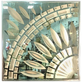 EXCEPTIONAL CHROME AND GLASS WALL MIRROR WITH UNUSUAL DESIGN BY GREG COPELAND