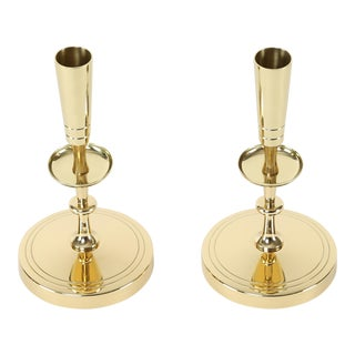 PAIR OF TOMMI PARZINGER BRASS CANDLE HOLDERS, CIRCA 1950S