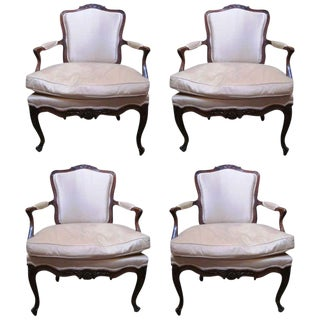 A Set of Four 18th Century French Carved Walnut Fauteuils