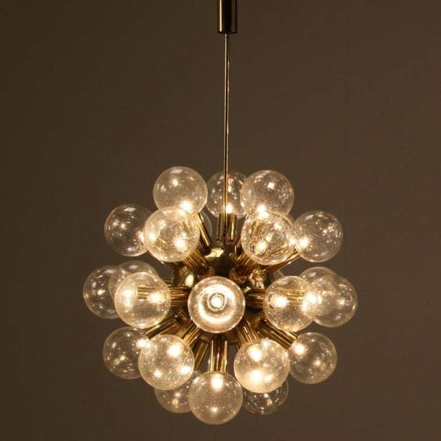 Image of Several Robert Haussmann Brass Sputnik Pendants Holding Twenty Eight Bulbs