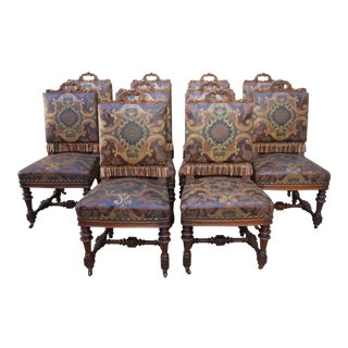 Ten Renaissance Style Leather Embossed Dining Chairs
