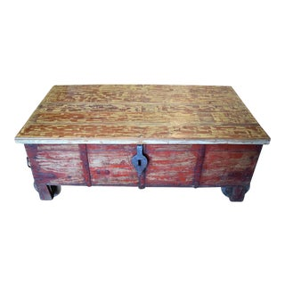 Large Distressed Red and Beige Rolling Trunk
