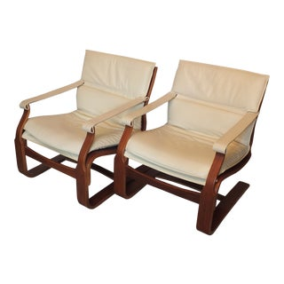 Nelo White Leather Lounge Chairs by Ake Fribyter - a Pair