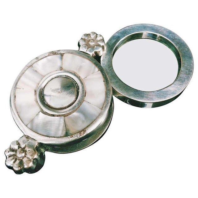 Image of Mother of Pearl Plate and Silver Magnifying Glass
