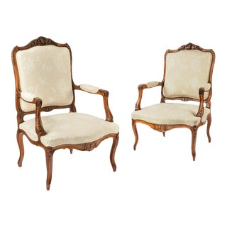 A pair of 19th century French walnut and upholstered armchairs