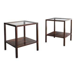 Pair of square side tables in jacaranda with glass tops