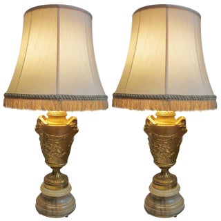 A Pair of 19th Century Bronze Lamps in the Manner of Clodion