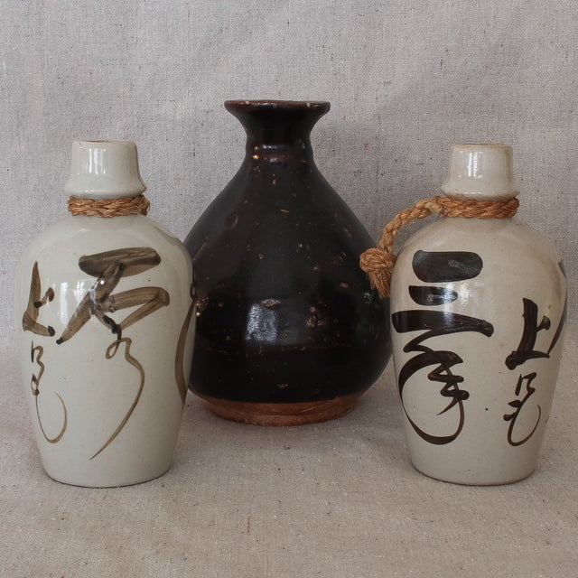 Image of Group of Antique Japanese Stoneware Sake Bottles