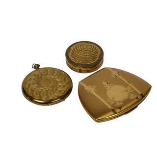 Trio of Gold Art Deco Compacts