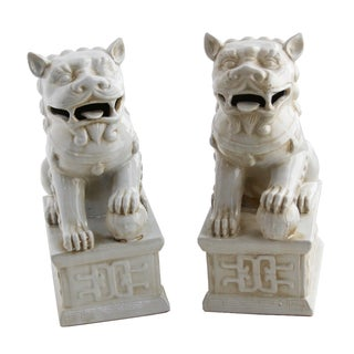 Ceramic Ivory Foo Dogs - a Pair
