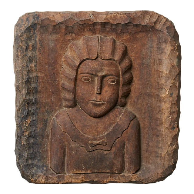 Image of Deeply Carved Wall Plaque of a Young Girl