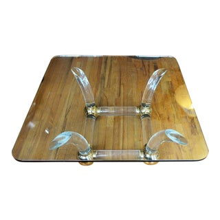 Thick Lucite Sabre Leg and Brass Coffee Table