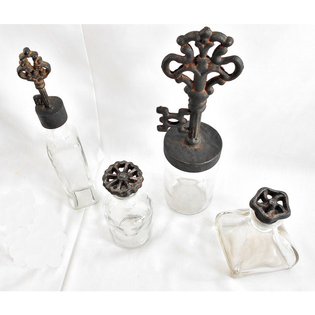 Image of Industrial Rustic Finial Glass Bottles - Set of 4