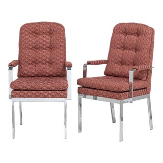A Pair of Milo Baughman Designed Nickel Framed Carver Chairs