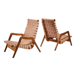 Pair of Mexican lounge chairs with leather webbing, 1950s