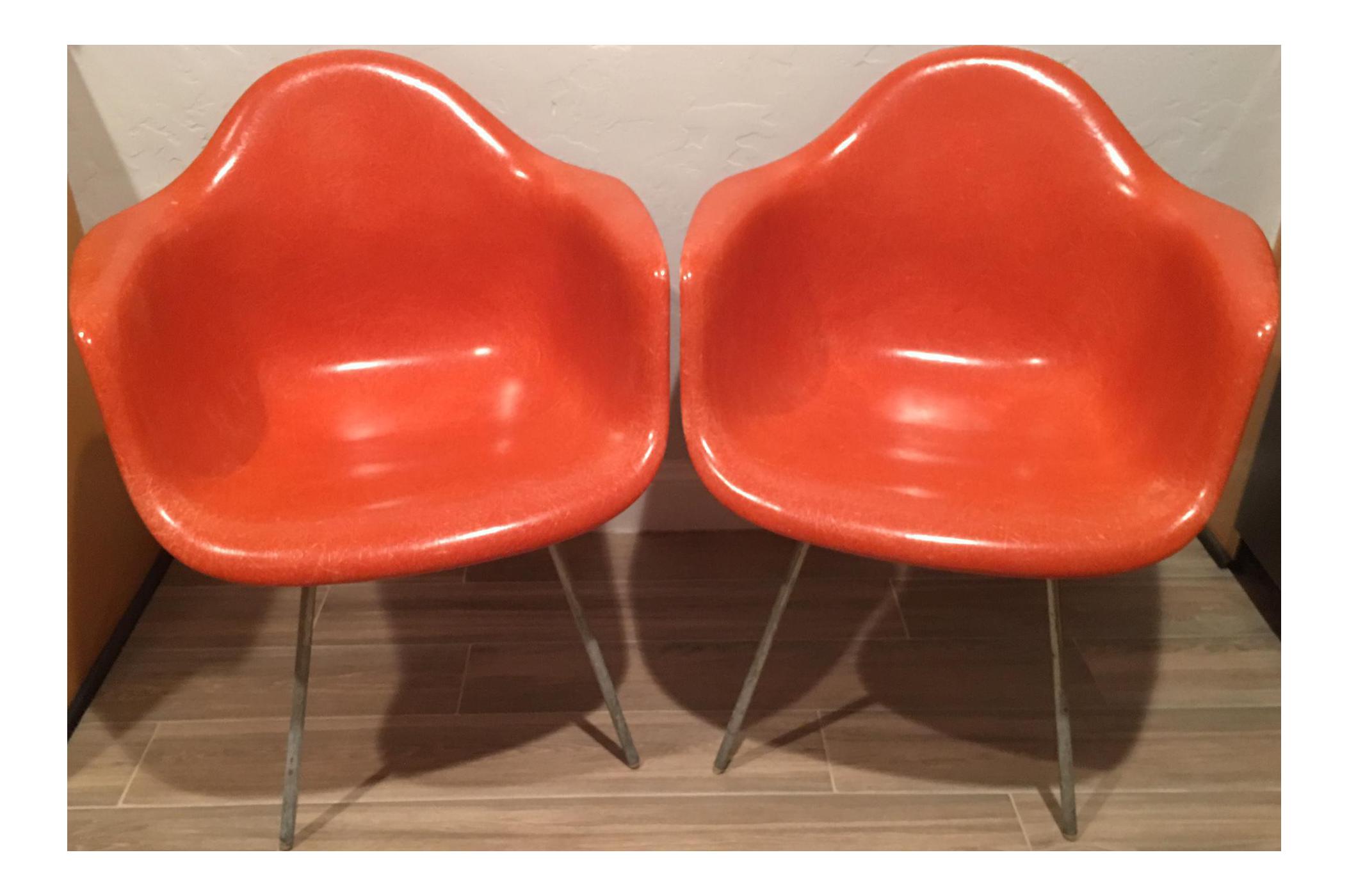 Herman Miller Red Fiberglass Shell Arm Chairs   A Pair