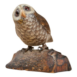 A Small Carved Owl Resting Upon a Log