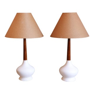PAIR OF MID-CENTURY TEAK AND WHITE CERAMIC TABLE LAMPS