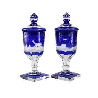 Pair Bohemian Two Layer Blue Cut Clear Glass Lidded Urns, 19th Century. Hunting Scene