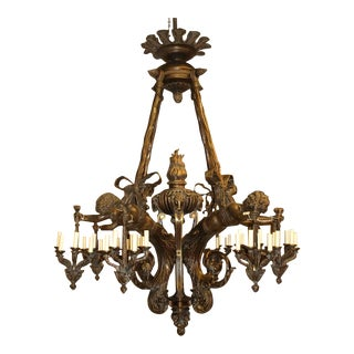 Antique Chandelier. Wood and bronze chandelier with cherubs