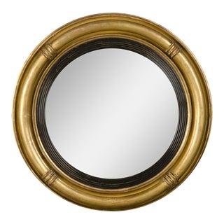 A Regency period gold leaf circular frame enclosing the original convex mirror glass from England c.1830 (22″dia.)