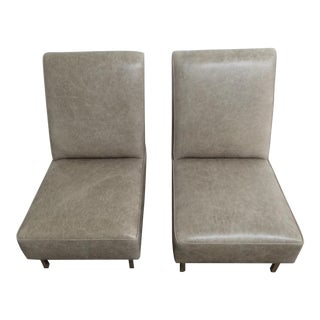 Pair of high Back low lounge chairs by Raphael/France