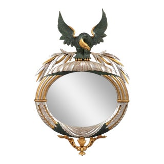 A RARE LATE FEDERAL OVAL MIRROR WITH CARVED EAGLE