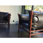 Image of Black Leather Arne Norell Ilona Easy Chairs - Pair