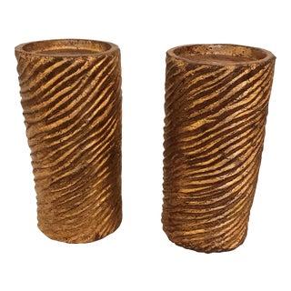 A Pair of Gold Leaf Column Textured Candlesticks