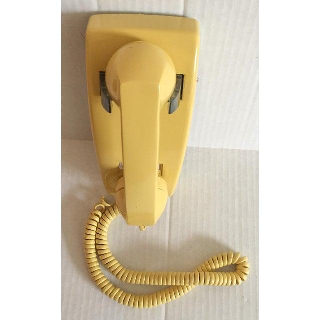 Image of Vintage Yellow Wall Mount Telephone