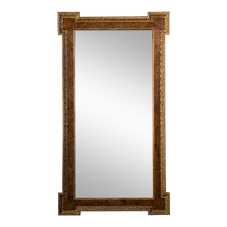 A grand William Kent style burl elm and gilded frame from England c.1875 enclosing the original mirror glass. (43″w x 61 1/2″h)