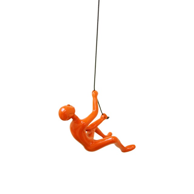 Orange Climbing Man Wall Art Sculpture - Image 1 of 5