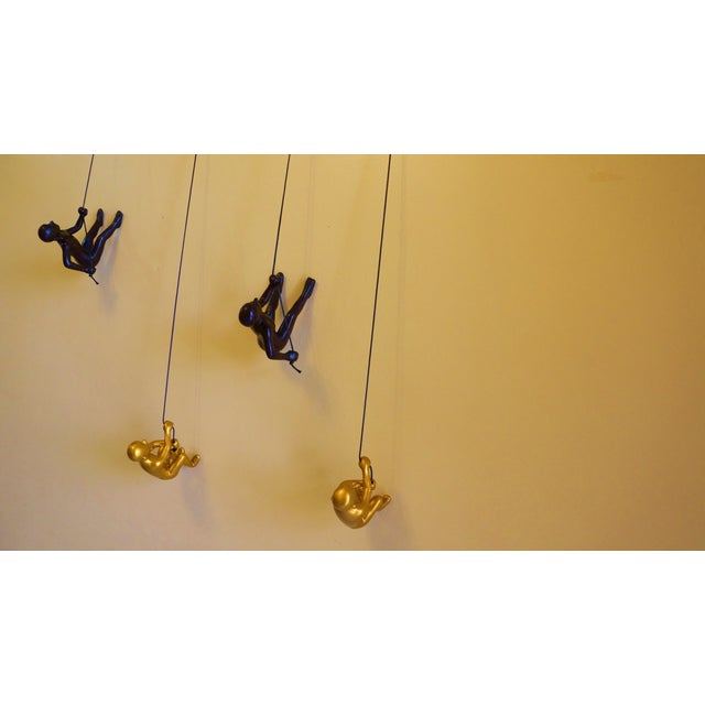 Image of New Brown & Gold Climbing Man Wall Art