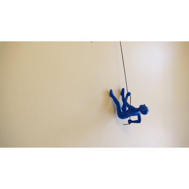 Image of Blue Position 2 Climbing Man Wall Art