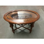 Image of Hand-Carved Oval Coffee Table