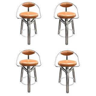 A set of 4 Vintage stools