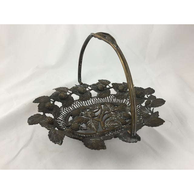 Image of Detailed Copper Basket with Aged Patina