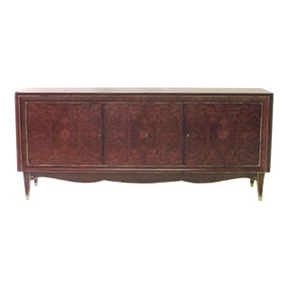 A handsome French mid-century modern tiger mahogany and amboyna wood sideboard in the manner of Jules Leleu