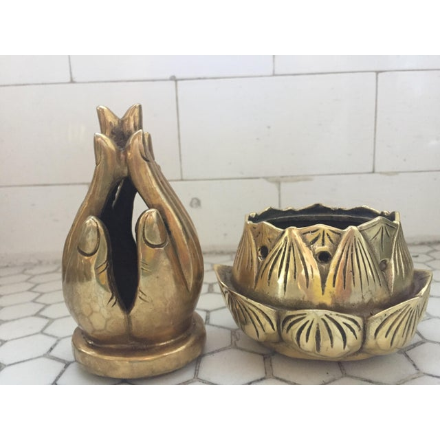Image of Hands on Lotus Brass Incense Burner