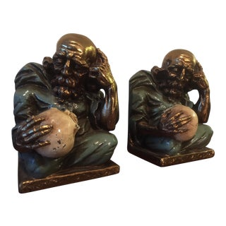 Man With Skull Bookends - A Pair