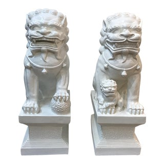 White Lacquered Foo Dogs - a Pair