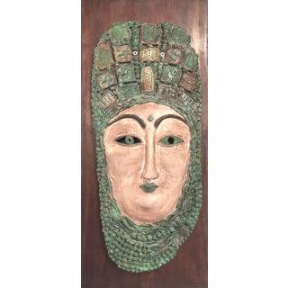 Female Pottery Mask on Wood Panel