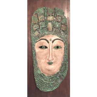 Female Pottery Mask on Wood Panel