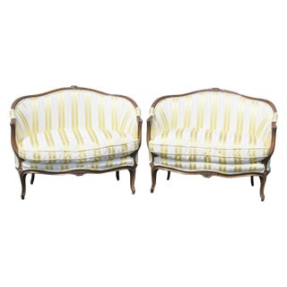 Louis XVI Style Carved Walnut Settees - A Pair