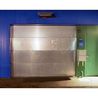 Shiny Door - Night Photograph by John Vias